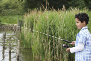 Going fishing on a beautiful spring or summer day is a perfect outdoor nature activity for kids.