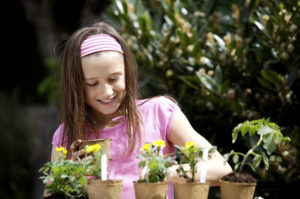 Spring is a great time for kids to plant flowers.